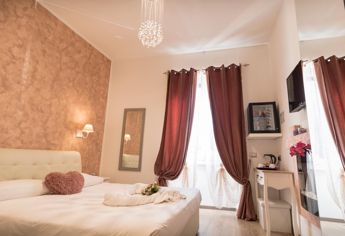 Foto Di Un Camino Acceso camera king superior-your vatican suite-il b&b nel cuore di roma